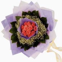 12 adet gül ve elyaflardan   Bursa orhangazi internetten çiçek siparişi